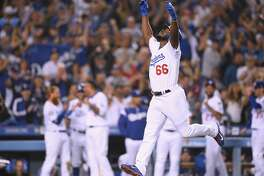 LOS ANGELES, CA - SEPTEMBER 19: Yasiel Puig #66 of the Los Angeles Dodgers celebrates his three run homerun to take a 5-2 lead over the Colorado Rockies during the seventh inning at Dodger Stadium on September 19, 2018 in Los Angeles, California. (Photo by Harry How/Getty Images)