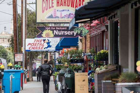 A woman walks down Cole Street near Carl Street in the Cole Valley neighborhood of San Francisco, Calif. Tuesday, Sept. 18, 2018.