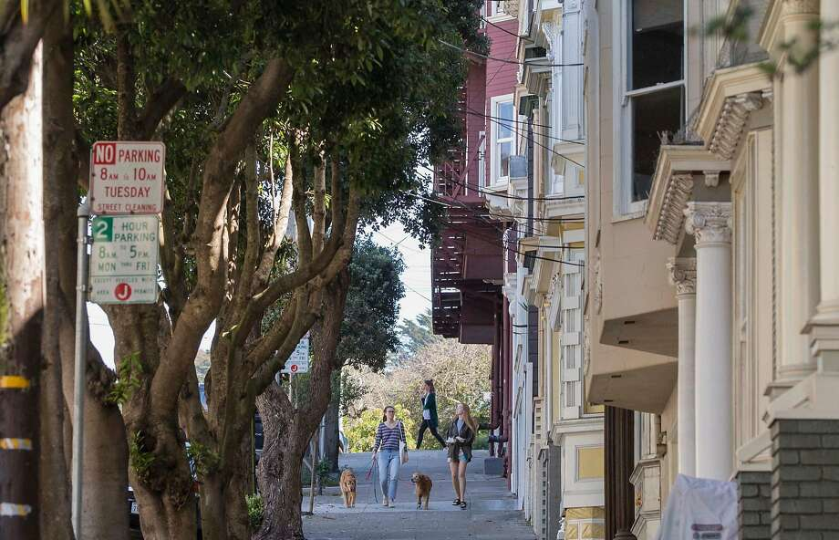 Women walk their dogs down Frederick Street in Cole Valley, where neighbors have complained about a mentally ill man harassing people. Photo: Jessica Christian / The Chronicle