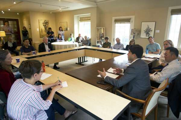 Matt Blumenthal, a Democratic candidate for State Representative - 147th District, talks during a community conversation about environmental challenges and opportunities facing the community and state inside the Bendel Mansion at the Stamford Museum & Nature Center in Stamford, Conn. on Thursday, Sept. 20, 2018. Blumenthal was joined by Democratic candidate for attorney general William Tong and Democratic candidate for the 36th District State Senate Alex Bergstein.