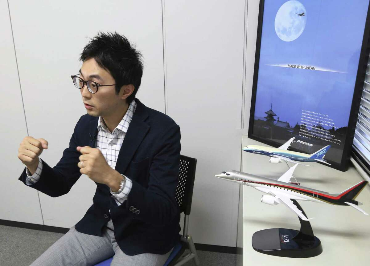 In this Sept. 4, 2018, photo, Fumiaki Ebihara, the flying-car chief at the Ministry of Economy, Trade and Industry, speaks during a interview with the Associated Press in Tokyo, Tuesday, Sept. 4, 2018. The Japanese government has started a flying car project, bringing together more than a dozen companies, including All Nippon Airways, electronics company NEC, Toyota-backed startup Cartivator and Uber, the ride-hailing service.