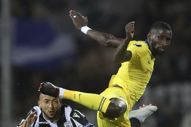 Chelsea's Antonio Rudiger, right, jumps for the ball with PAOK's Omar El Kaddouri during a Group L Europa League soccer match between PAOK and Chelsea at Toumba stadium in the northern Greek port city of Thessaloniki, Thursday, Sept. 20, 2018. (AP Photo/Thanassis Stavrakis)
