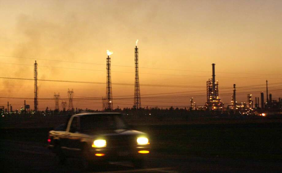 A truck passes by a giant refinery in Salamanca, 170 miles (280 kms) northwest of Mexico City Photo: MARCO UGARTE /AP / AP