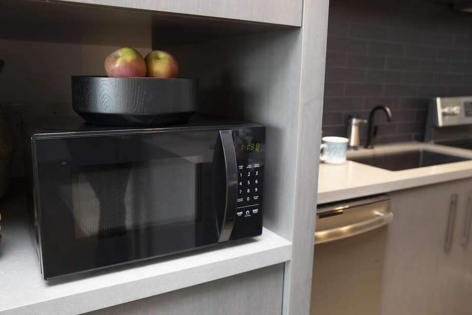 """FILE PHOTO: An """"Amazonbasics Microwave,"""" which can be controlled by Alexa, is pictured at  Amazon Headquarters shortly after being launched, on September 20, 2018 in Seattle Washington. Photo: Stephen Brashear, Getty Images"""