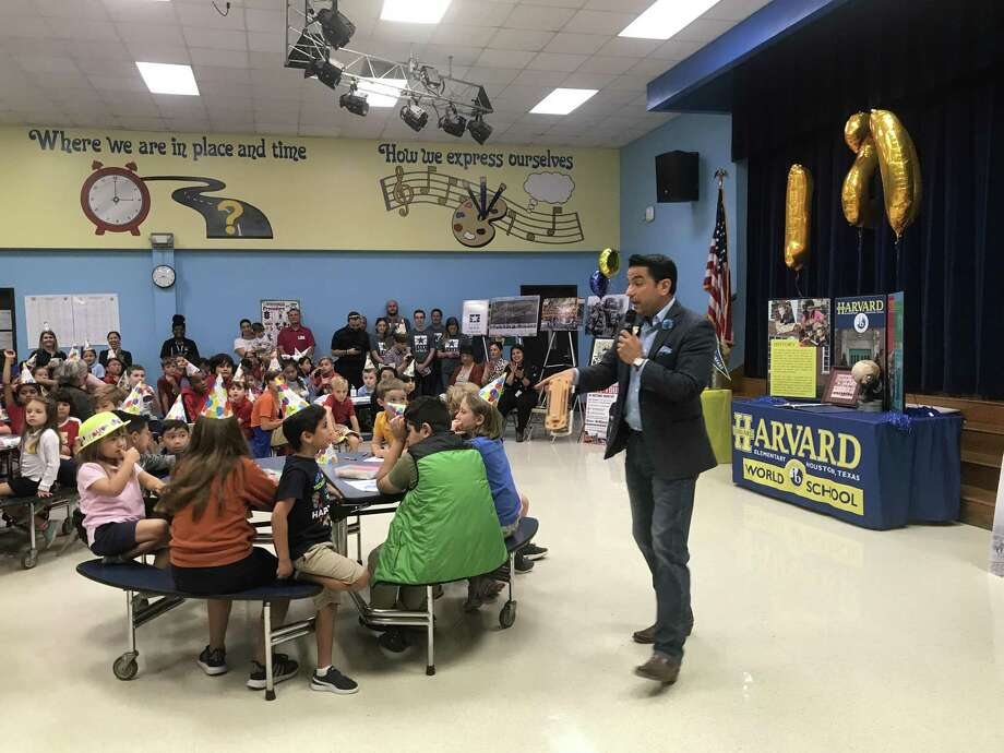 Harvard Elementary School celebrated 120 years of education in the Heights with a special program held Sept. 18 in the school cafeteria. R.W. McKinney, Houston historian and Mister McKinney of Mister McKinneys Historic Houston, stopped by to teach Harvard's kindergartners and fifth graders about the history of their school and neighborhood. Photo: Courtesy Photo By Mister McKinney's Historic Houston