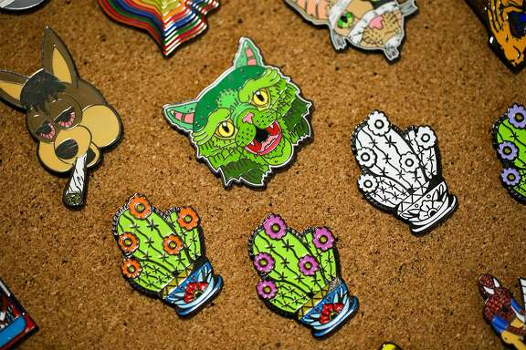 Ben Martin's Bad Pins designs celebrate and satirize all sorts of familiar icons, including those best known in San Antonio. To wit: a Bad Pins design (left) that looks like a stoned Spurs Coyote.