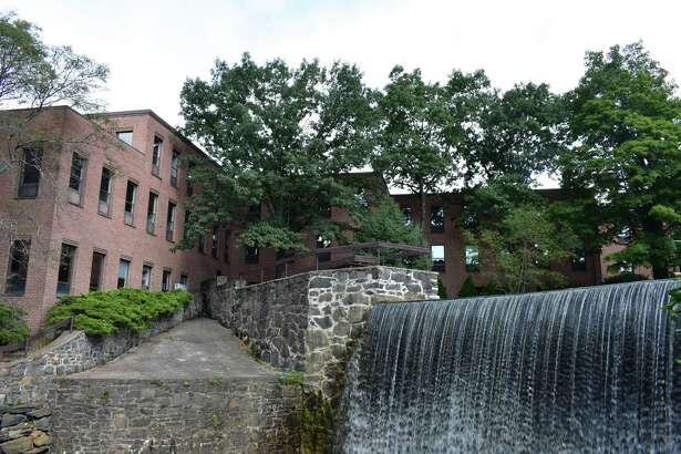 The waterfall at The Mill office complex at 10 Glenvill St. in Greenwich, Conn., with the property's owners proposing a partial conversion to apartments.