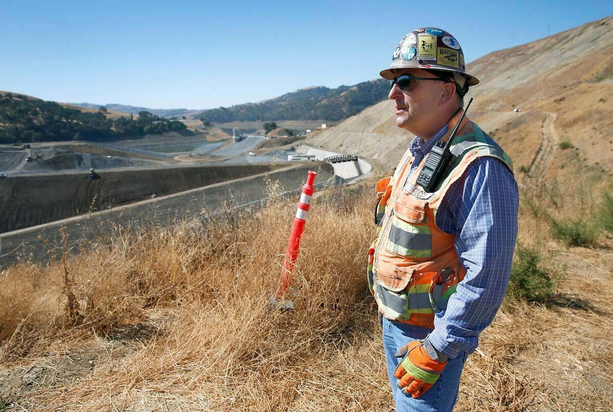Field operations manager John Rocca views the Calaveras Dam project from a hilltop in Fremont, Calif. on Wednesday, Sept. 19, 2018. The extensive reconstruction project of the dam, which broke ground in 2011, is nearing completion and is on target to begin filling with water sometime this winter.