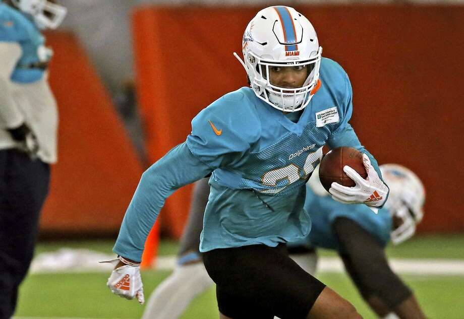 "FILE - In this Aug. 28, 2018 file photo, Miami Dolphins safety Minkah Fitzpatrick runs a drill during NFL football training camp in Davie, Fla. The Dolphins rookie safety wants to trademark his nickname but says he'd be happy to share it with Tampa Bay Buccaneers quarterback Ryan Fitzpatrick. Both go by ""FitzMagic. (David Santiago/Miami Herald via AP) Photo: David Santiago / Associated Press"
