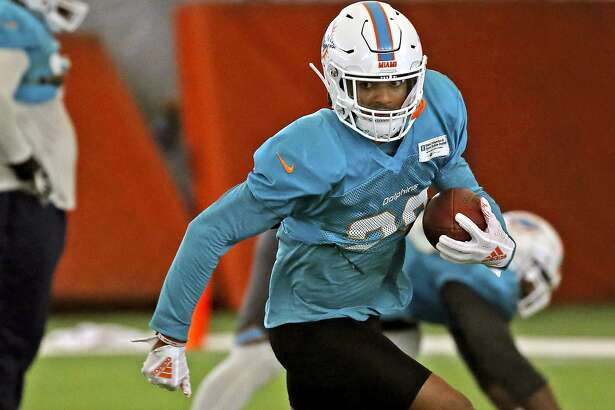FILE - In this Aug. 28, 2018 file photo, Miami Dolphins safety Minkah Fitzpatrick runs a drill during NFL football training camp in Davie, Fla. The Dolphins rookie safety wants to trademark his nickname but says he�d be happy to share it with Tampa Bay Buccaneers quarterback Ryan Fitzpatrick. Both go by �FitzMagic. (David Santiago/Miami Herald via AP)
