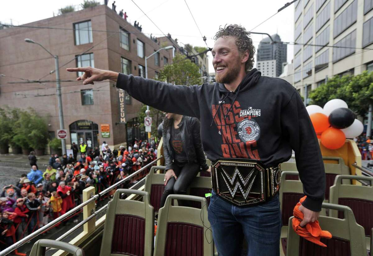 San Francisco Giants baseball player Hunter Pence waves to fans during the victory parade for the 2014 World Series Champion San Francisco Giants on Friday, Oct. 31, 2014 in San Francisco. (AP Photo/Marcio Jose Sanchez)