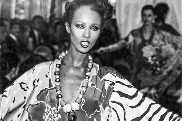 The legendary model Iman showed off Oscar de la Renta's caftan of hand-painted silk crepe de chine in the summer 1982.