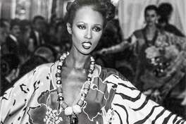 The legendary model Iman showed off Oscar de la Renta's caftan of hand-painted silk crepe de chine in the summer 1982.