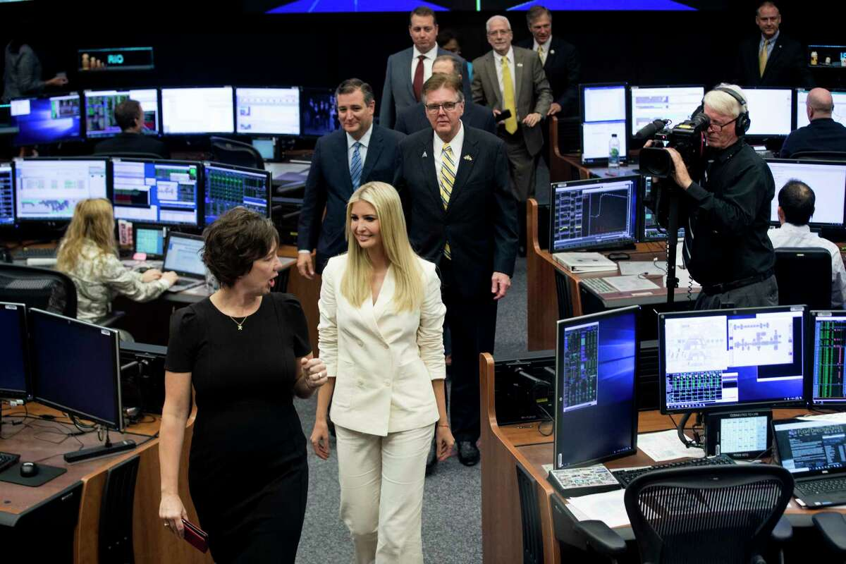 NASA Chief Flight Director Holly Ridings, leads Ivanka Trump, senior adviser to the president, into the International Space Station flight control room during a visit to the Johnson Space Center on Thursday, Sept. 20, 2018, in Houston.