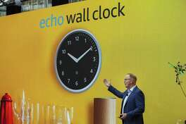 David Limp, senior vice president of devices and services at Amazon.com, presents the Amazon Echo Wall Clock in Seattle on Thursday. Amazon.com unveiled its vision for smart homes powered by the Alexa voice assistant, with a dizzying array of new gadgets and features for almost every room in the house.