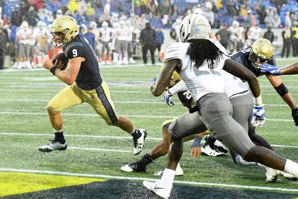 Navy's Zach Abey was in at quarterback when he scored this game-winning touchdown against Memphis at Navy-Marine Corps Memorial Stadium.