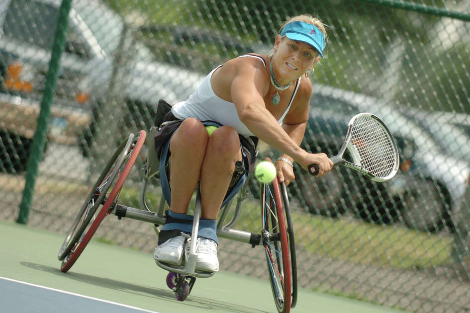 Stamford_072805_ Karin Korb returns a shot during her women's 35 singles match in the 79th Annual National Public Parks Championship at Scalzi Park. Korb made history Thursday by being the first wheelchair player to defeat an able-bodied player. Kathleen O'Rourke/Staff photo