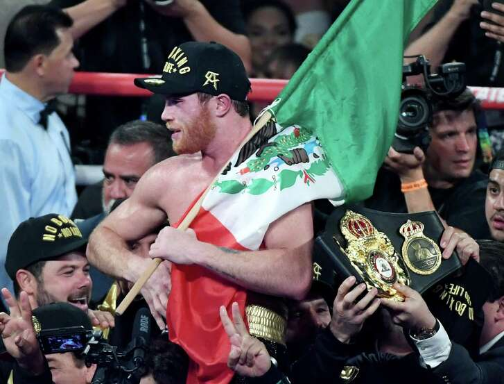 LAS VEGAS, NV - SEPTEMBER 15: Canelo Alvarez holds a Mexican flag as he celebrates his majority-decision win over Gennady Golovkin after their WBC/WBA middleweight title fight at T-Mobile Arena on September 15, 2018 in Las Vegas, Nevada. (Photo by Ethan Miller/Getty Images)