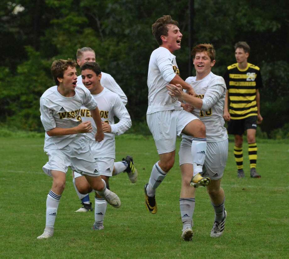 Weston's Henry Cohen celebrates his winning goal against Barlow with his teammates Thursday. Photo: Alex Von Kleydorff / Hearst Connecticut Media / Norwalk Hour