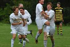 Weston's Henry Cohen celebrates his winning goal against Barlow with his teammates Thursday.