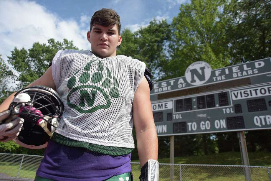 Sam Papp — a 6-foot-5, 255-pound two-way lineman for the Norwalk football team — is a leader both on and off the field. Photo: John Nash / Hearst Connecticut Media