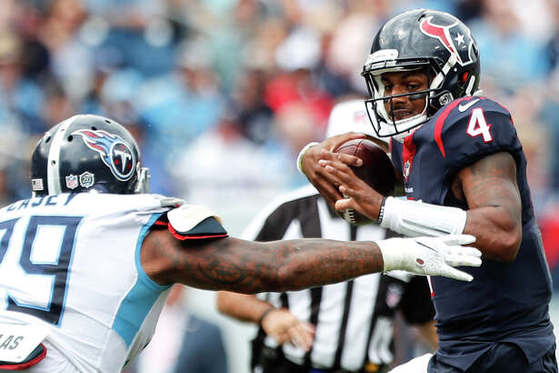Tennessee Titans defensive tackle Jurrell Casey (99) pressures Houston Texans quarterback Deshaun Watson (4) during the second quarter of an NFL football game at Nissan Stadium on Sunday, Sept. 16, 2018, in Nashville.