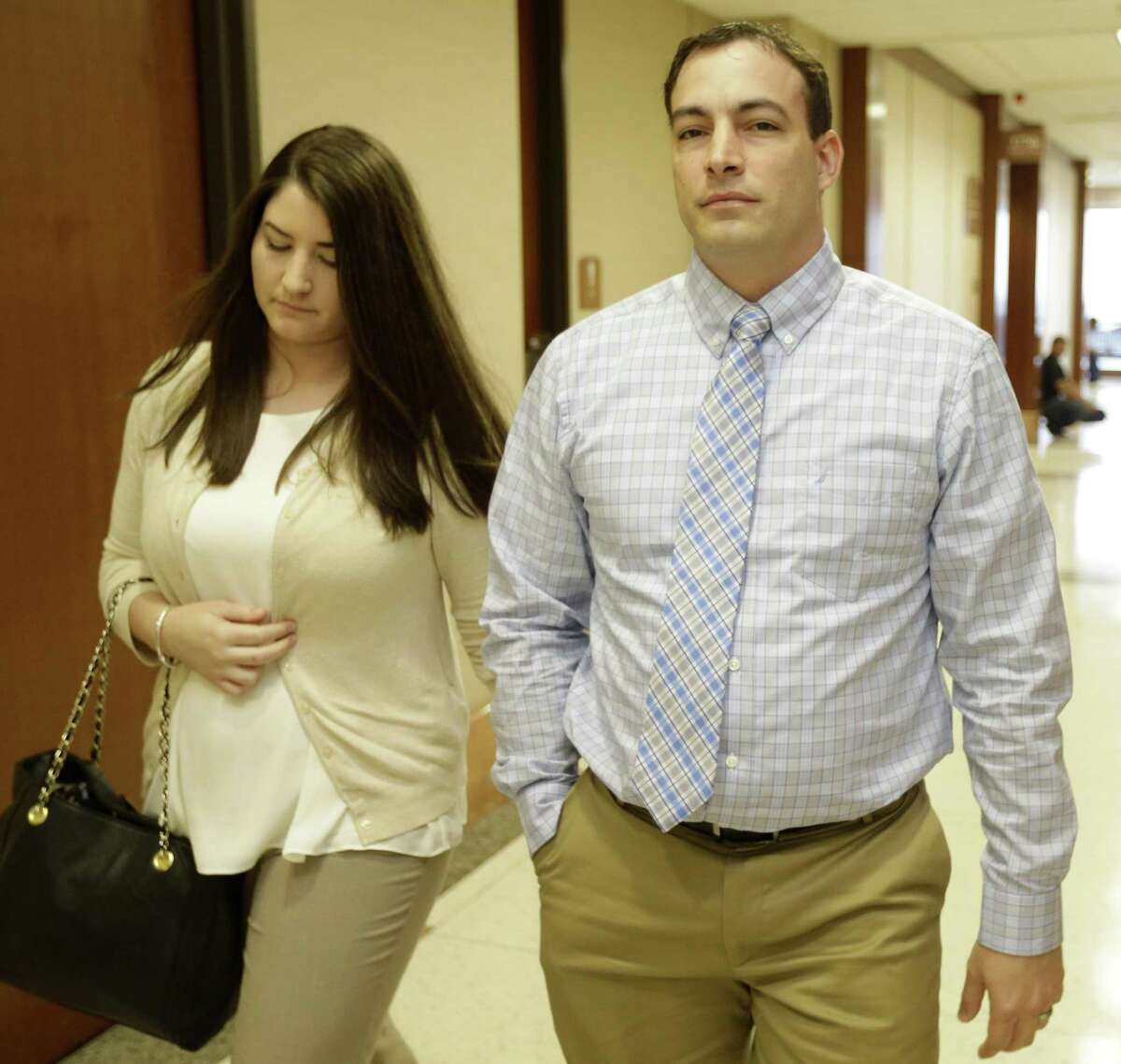 Blaine Boudreaux, right, leaves fom the 177th state District Court at the Harris County Criminal Courthouse, 1201 Franklin, Wednesday, Aug. 26, 2015, in Houston. He is accused of causing four crashes in one day earlier this summer-two of them fatal. ( Melissa Phillip / Houston Chronicle )
