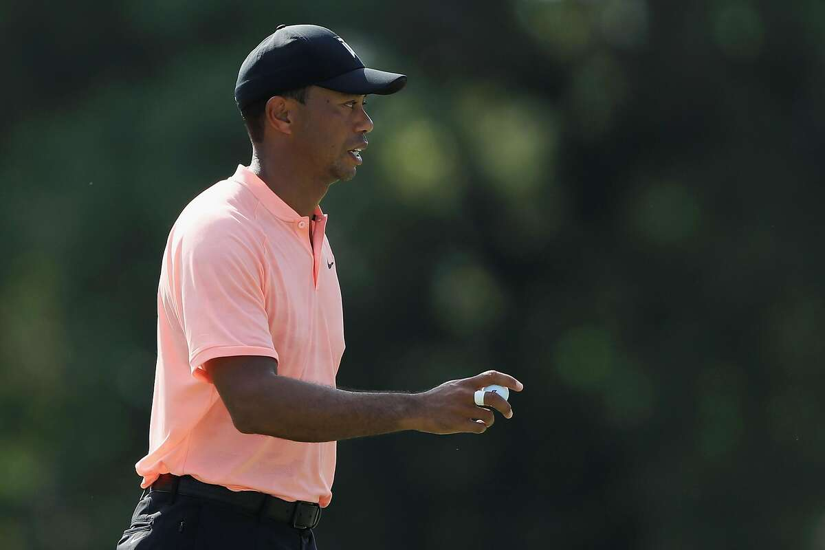 ATLANTA, GA - SEPTEMBER 20: Tiger Woods of the United States acknowledges the crowd on the 17th green during the first round of the TOUR Championship at East Lake Golf Club on September 20, 2018 in Atlanta, Georgia. (Photo by Sam Greenwood/Getty Images)