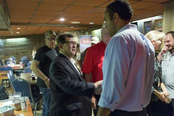 State Senator-elect Pete Flores, left, talks Wednesday, Sept. 20, 2018 at Sammy's Restaurant in Castroville, with US Representative Will Hurd (R, TX-23) during a Hurd campaign stop.