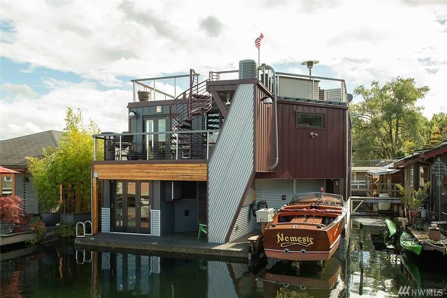 For just under $2M, you could be the next owner of this capacious floating home on Portage Bay. Photo: Robert Brittingham. Drone Photos: Rudy Lopez/via Windermere
