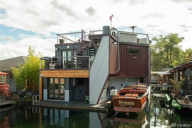 For just under $2M, you could be the next owner of this capacious floating home on Portage Bay.
