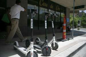 Electric Bird scooters are lined up along Soledad Street in downtown San Antonio on July 1, 2018. Riders can rent any one and return it whenever they please.
