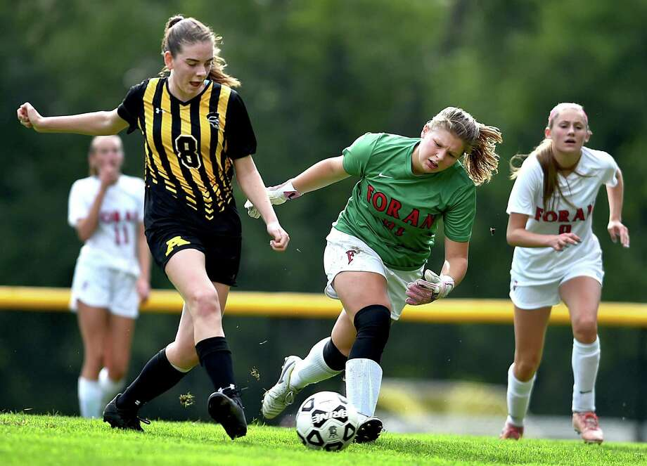 Amity's Ruth Cortright (8) gets one past Foran goalkeeper Abigail Lucas during Thursday's game in Woodbridge. Photo: Catherine Avalone / Hearst Connecticut Media / New Haven Register