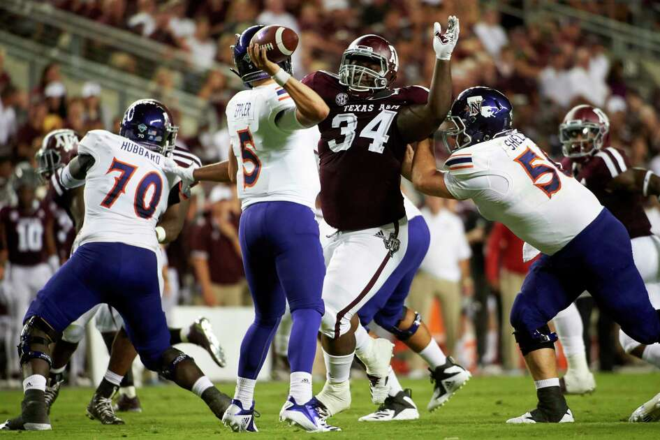 COLLEGE STATION, TX - AUGUST 30: Daylon Mack #34 of the Texas A&M Aggies rushes Shelton Eppler #5 of the Northwestern State Demons during the first half of a football game at Kyle Field on August 30, 2018 in College Station, Texas.