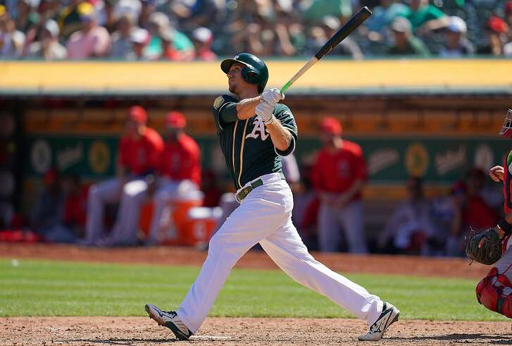 OAKLAND, CA - SEPTEMBER 20:  Stephen Piscotty #25 of the Oakland Athletics swings and watches the flight of his ball as he hits a three-run home run against the Los Angeles Angels of Anaheim in the bottom of the third inning at Oakland Alameda Coliseum on September 20, 2018 in Oakland, California.  (Photo by Thearon W. Henderson/Getty Images)