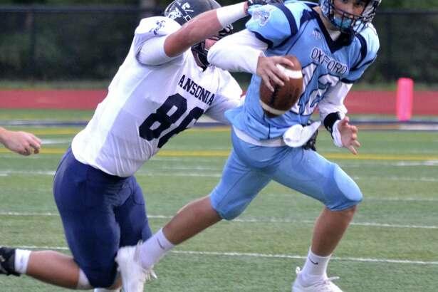 Ansonia's Garrett Cafaro sacks Oxford quarterback Cayden Mitchell on Thursday.