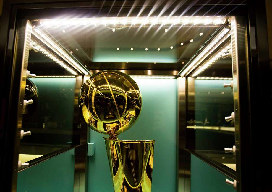 One of two new NBA Championship Larry O'Brien trophies commemorating the Rockets' back-to-back NBA titles in 1994 and 1995 is on display at Tiffany & Co. in The Galleria, Thursday, Sept. 20, 2018 in Houston. Photo: Mark Mulligan, Staff Photographer / © 2018 Mark Mulligan / Houston Chronicle
