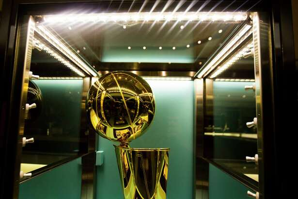 One of two new NBA Championship Larry O'Brien trophies commemorating the Rockets' back-to-back NBA titles in 1994 and 1995 is on display at Tiffany & Co. in The Galleria, Thursday, Sept. 20, 2018 in Houston.