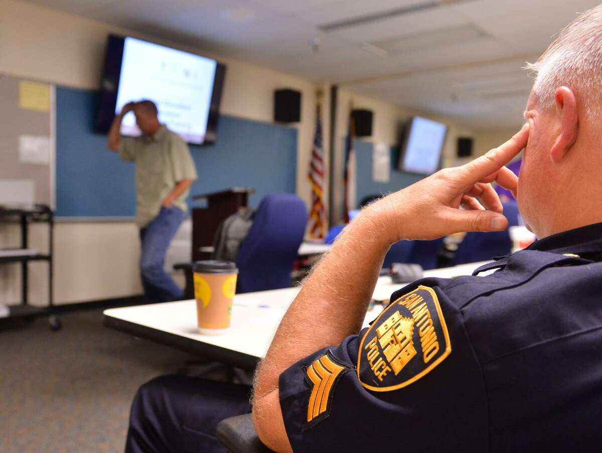 Members of the San Antonio Police Department listen to Mark Kinzly, co-founder/streetologist with the Texas Overdose Naloxone Initiative, talk about the use of Naloxone in overdose situations during a training session Sept. 18, 2018. The training is part of the Opioid Task Force started last year by San Antonio and Bexar County.
