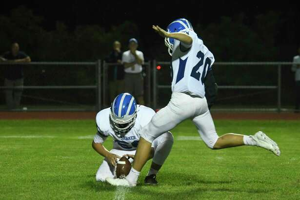 Shaker's Frankie Congiusta (66) and Jack Leto (20) make the kick for an extra point following a touchdown against Saratoga during a game on Friday, Sept. 14, 2018, in Saratoga Springs, N.Y. (Jenn March, Special to the Times Union)