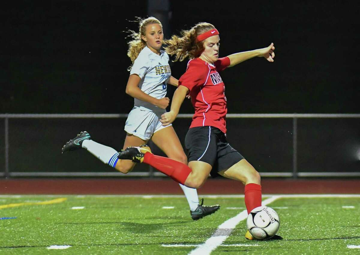 Kacey Lawrence (6) of Masuk Panathers takes a shot on goal during a match against the Newtown Nighthawks on Thursday Sept 20, 2018 at Masuk High School in Monroe, Connecticut.