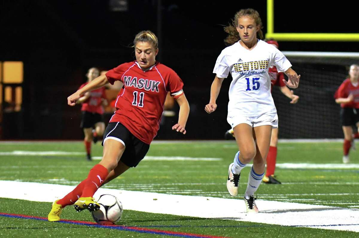 Giavanna DeLorenzo (11) of Masuk Panathers turns upfield during a match against the Newtown Nighthawks on Thursday Sept 20, 2018 at Masuk High School in Monroe, Connecticut.
