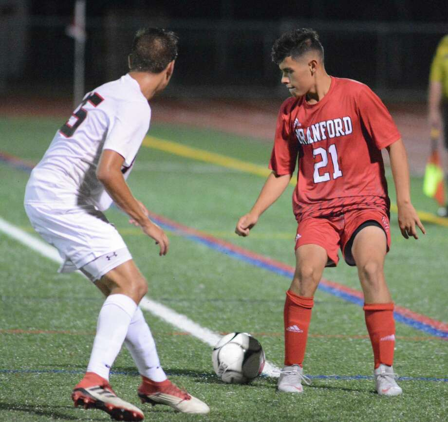 Branford's Matt Cordero, right, and Cheshire's Jared Andrea battle for a loose ball during Thursday's game. Photo: Dave Phillips / For Hearst Connecticut Media