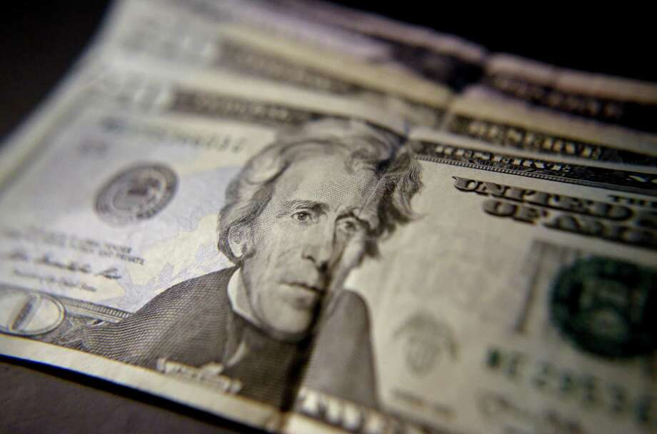 This June 13, 2018, shows United States currency in Zelienople, Pa. U.S. middle-class household incomes rose for the third straight year in 2017, as more Americans are working and the number of people with full-time jobs increased. (AP Photo/Keith Srakocic) Photo: Keith Srakocic /Associated Press / Copyright 2018 The Associated Press. All rights reserved.