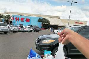 A customer at the HEB Store on Saunders Street holds one of several plastic bags that were provided at the store Wednesday, September 19, 2018.