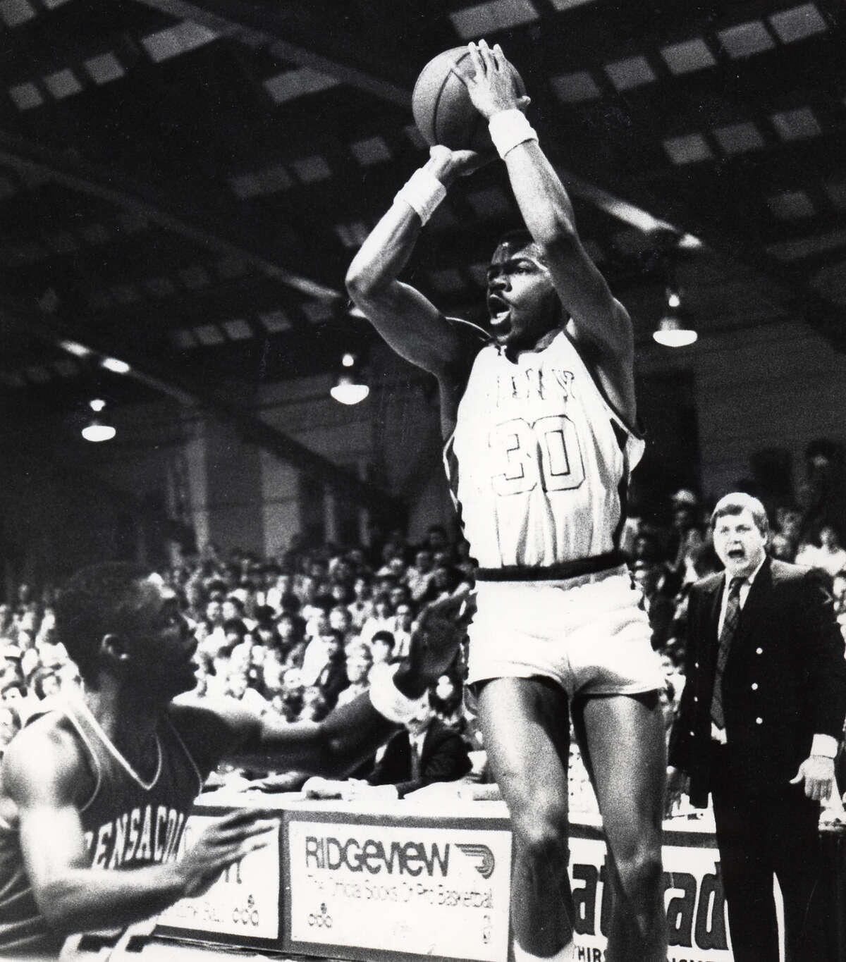 Albany Patroon's Derrick Rowland goes up for a jump shot during a game at the Albany Armory on April 8, 1988. Pensacola coach is yelling in background. (Times Union archive)