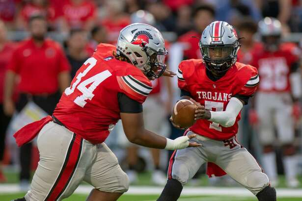 South Houston Trojan QB Torrqnce Stevens (7) hands the ball over to RB Brodrick Williams (34) during the first half of action between Humble vs. South Houston during a high school football game at the Pasadena Veterans Memorial Stadium, Thursday, September 20, 2018, in Pasadena. (Juan DeLeon/Contributor)