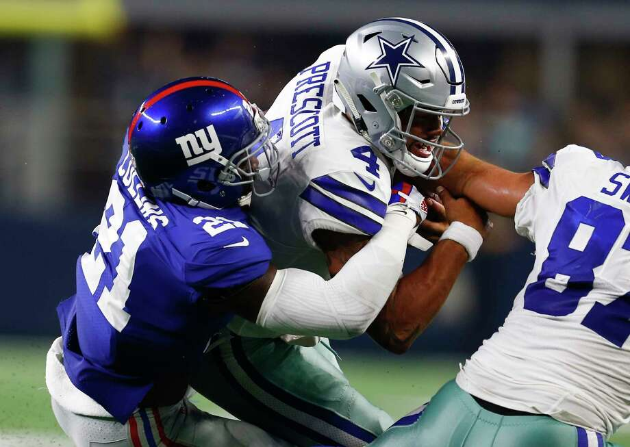 PHOTOS: John McClain's Week 3 predictions  Dallas Cowboys quarterback Dak Prescott (4) is tackled by New York Giants defensive back Landon Collins (21) after carrying the ball during the second half on Sunday, Sept. 16, 2018, at AT&T Stadium in Arlington, Texas.  >>>See John McClain's predictions for the third week of NFL action ... Photo: Jim Cowsert, TNS / Fort Worth Star-Telegram