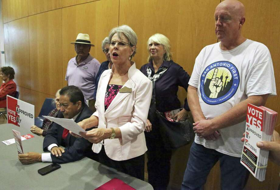 Reinette Kings speaks as groups for the city charter amendment remain at UTSA downtown after the cancellation of a debate forum with Chis Steele and Mayor Ron Nirenberg on Sept. 20. These amendments are damaging to local governance. Photo: Tom Reel /Staff Photographer / 2017 SAN ANTONIO EXPRESS-NEWS