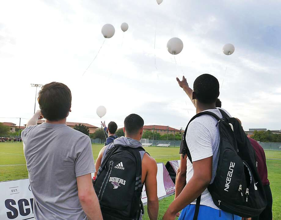 TAMIU Athletes, Athletic Department staff, Laredo Heat representatives and family of TAMIU Trainer, Ernst Feisner, who passed away this week released white balloons in his memory at the Lady Dustdevil soccer match, Thursday, September 20, 2018 at the TAMIU Soccer Field. Photo: Cuate Santos /Laredo Morning Times / Laredo Morning Times